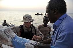 Somali fisherman Mohamed Abdirahman Mohamud speaks with a me